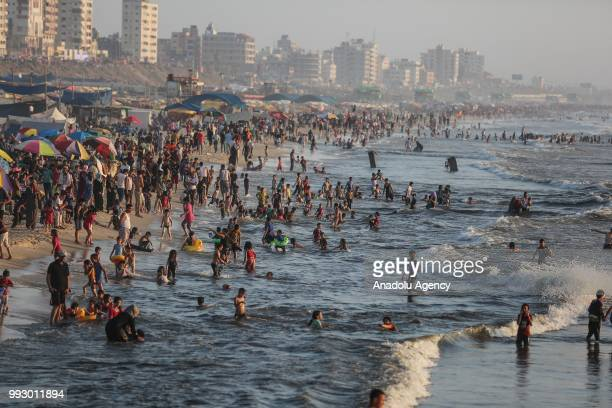 Palestinians gather at a seaside to cool themselves and spend their time for current power cut during a hot day in Gaza City Gaza on July 06 2018