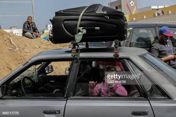 Palestinians gather at the Rafah boder crossing as they wait to travel into Egypt after the passage was opened for three days for humanitarian cases,...