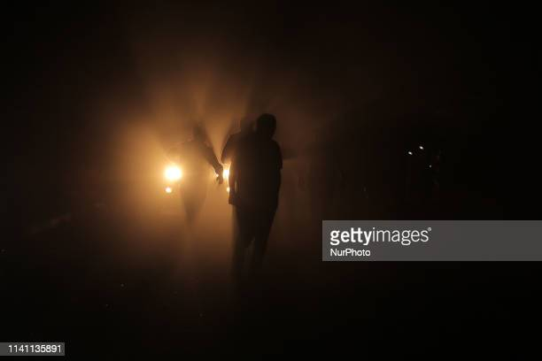 Palestinians gather billow following airstrikes by Israel in response to rockets fired by Palestinian militants on May 4 2019 Gaza militants today...