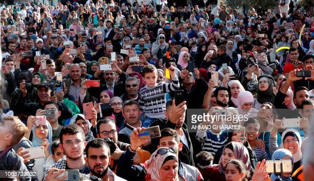 Palestinians gather during a ceremony commemorating the birth of Prophet Mohammed known in Arabic as 'alMawlid alNabawi' outside the Dome of the Rock...
