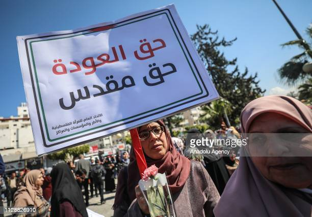 Palestinians gather during a demonstration on the occasion of 8 March International Women's Day as they protest Trump's socalled deal of the century...