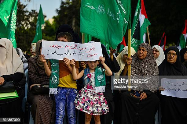 Palestinians gather during a protest demanding to find four Palestinians who were kidnapped in North Sinai Governorate of Egypt last year in front of...