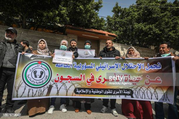 Palestinians gather for a demonstration to demand coronavirus protection for Palestinian prisoners held in Israeli jails in Gaza City Gaza on March...