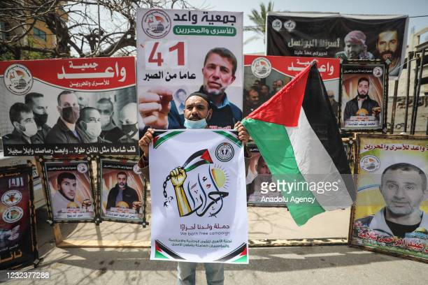 """Palestinians gather for a demonstration to support Palestinian prisoners in Israeli jails, marking the """"Palestine Prisoners' Day"""" in front of the..."""