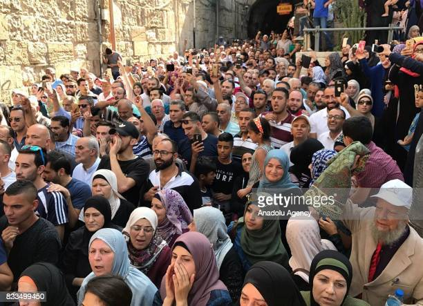 Palestinians gather in front of the Haremi Sharif to celebrate after Israeli authorities decided to remove the iron barricades from the alEsbat Gate...