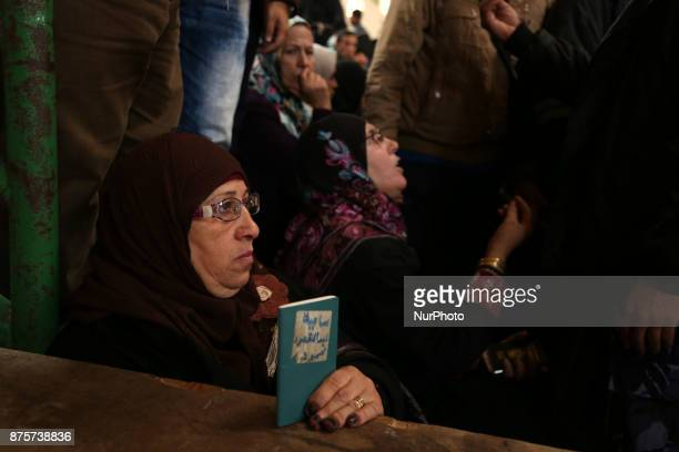 Palestinians gather in Khan Younis in the southern Gaza strip on November 18 2017 as they await clearance to take a bus to travel through the Rafah...