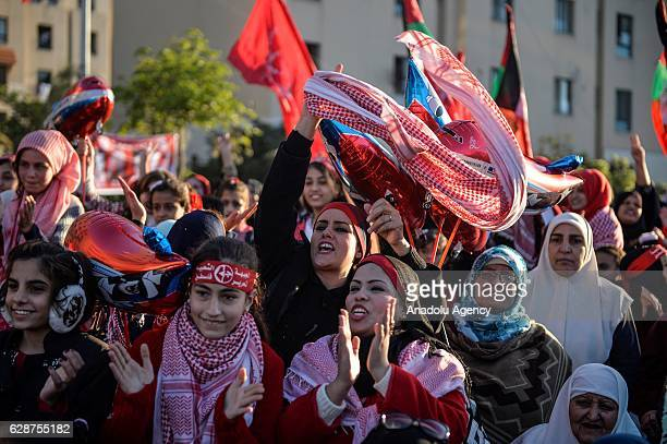 Palestinians gather to attend a rally in Gaza City marking the 49th anniversary of the founding of the Popular Front for the Liberation of Palestine...
