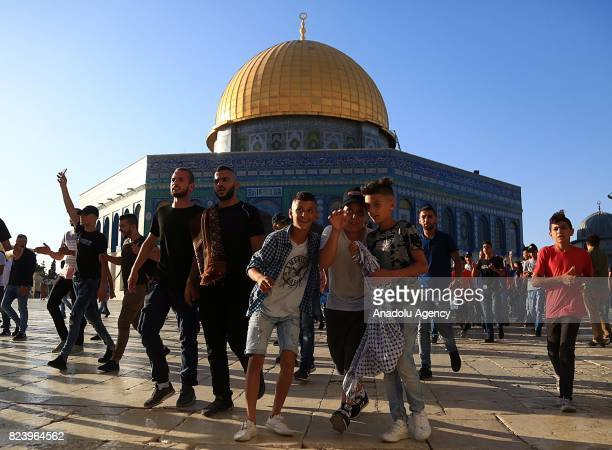 Palestinians gather to celebrate near Jerusalems Old City as they enter the Al Aqsa Mosque following the removal of Israeli security measures at the...