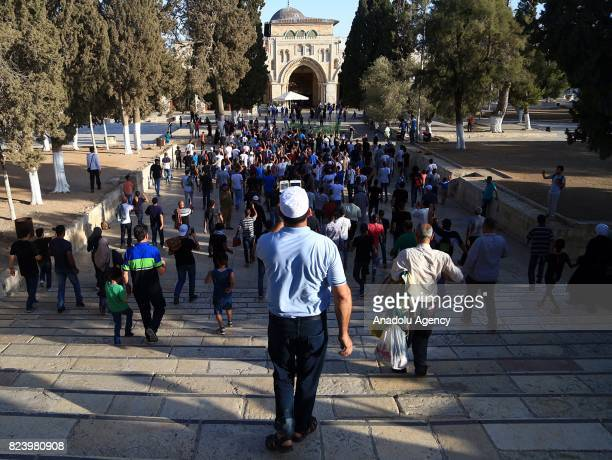 Palestinians gather to celebrate near Jerusalems Old City as they enter the Al Aqsa Mosque following the removal of Israel's restrictions at the...
