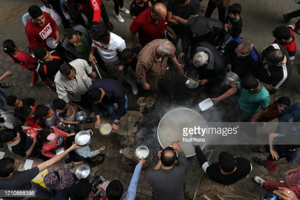 Palestinians gather to get soup offered for free in Gaza City April 24 on the first day of the Muslim holy month of Ramadan