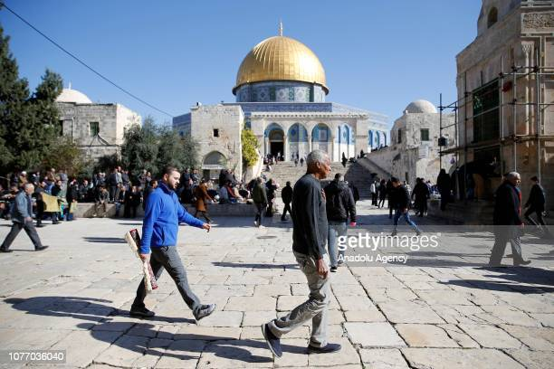 Palestinians gather to perform the Friday prayer at AlAqsa Mosque Compound in Jerusalem on January 04 2019