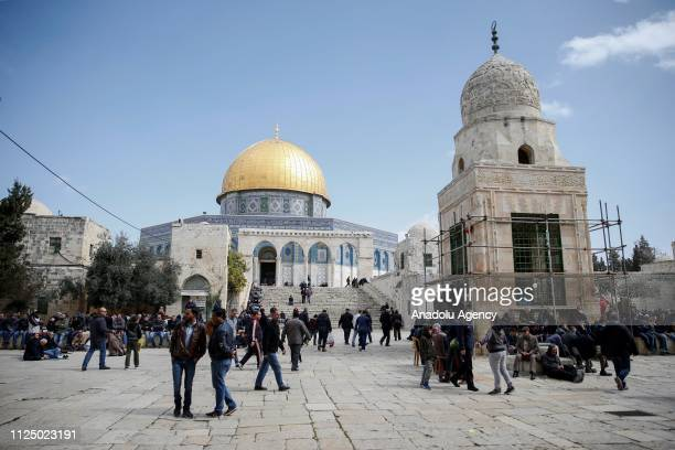 Palestinians gather to perform the Friday prayer at the AlAqsa Mosque Compound in Jerusalem on February 15 2019 According to Islamic belief the Al...