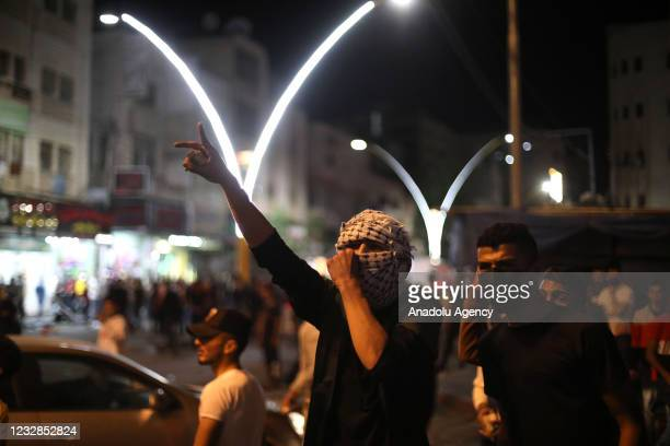 Palestinians gather to protest against Israeli attacks in Jerusalem and Gaza Strip as Israeli forces intervene on May 13 in Hebron, West Bank.