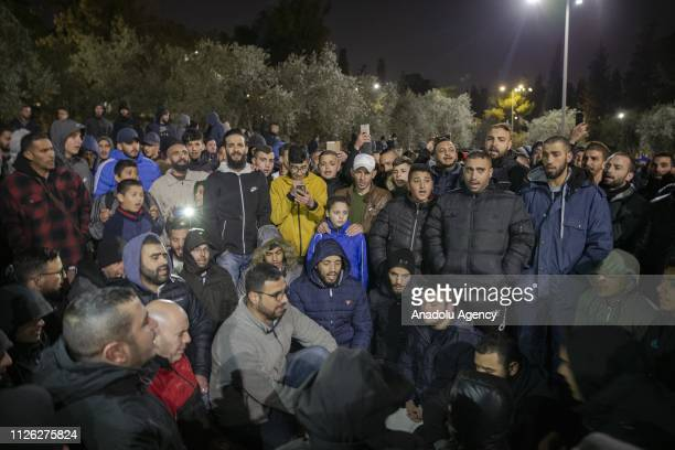 Palestinians gather to show their reactions in front of AlRahma Gate of AlAqsa Mosque Compound after it was chained by Israeli police in Jerusalem on...