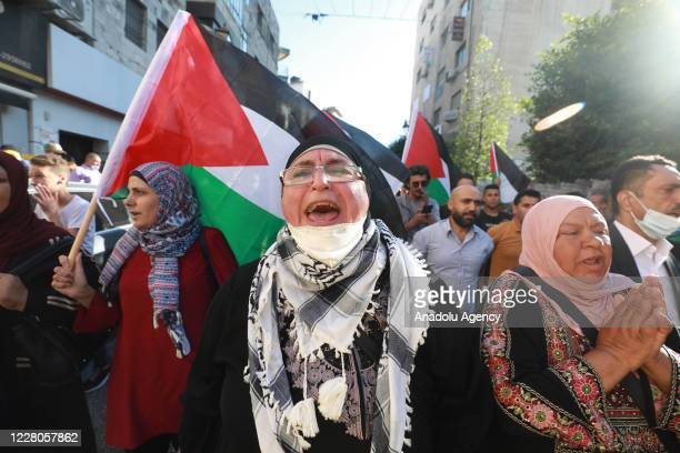 Palestinians gather to stage a protest against the agreement between United Arab Emirates' and Israel to deal normalization of relations, and the...