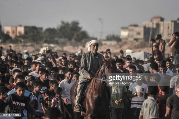 Palestinians gather to watch the horse race at the airfield of Yasser Arafat International Airport in Rafah, Gaza on September 09, 2018. Gaza...