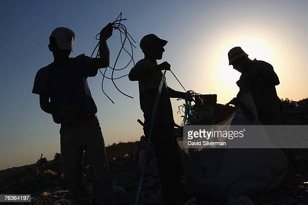 Palestinians gather wiring from Israeli refuse which has been dumped August 28 2007 near the Palestinian village of Qibya in the West Bank Tons of...