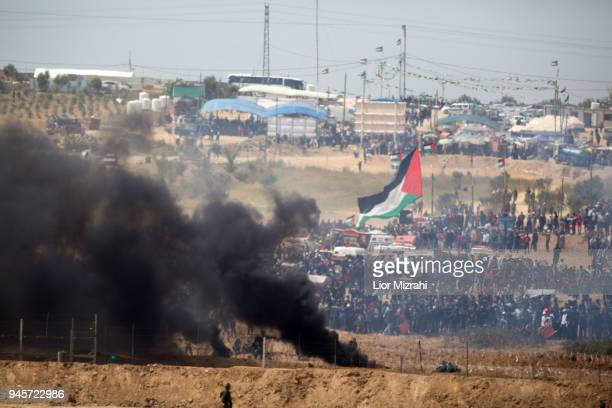 Palestinians gathered for a protest on the Israel-Gaza border on April 13, 2018 in Netivot, Israel. Thousands of Gaza residents assembled on Friday...