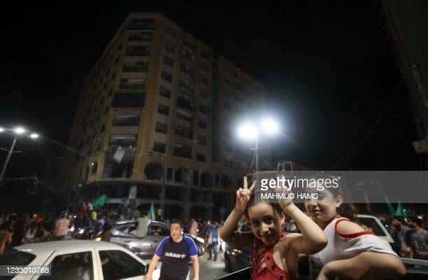 Palestinians girls celebrate in the streets following a ceasefire brokered by Egypt between Israel and the ruling Islamist movement Hamas in the Gaza...