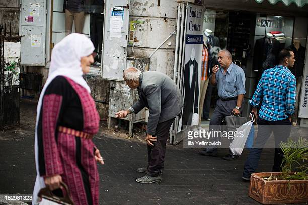 Palestinians go about their business on the streets of Ramallah on September 23 2013 in Ramallah WestBank The West Bank and Gaza Strip are inhabited...