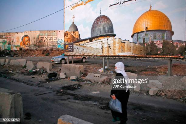Palestinians going to pray at the alAqsa mosque compound in Jerusalem make their way through the Israeli Qalandia checkpoint in the occupied West...