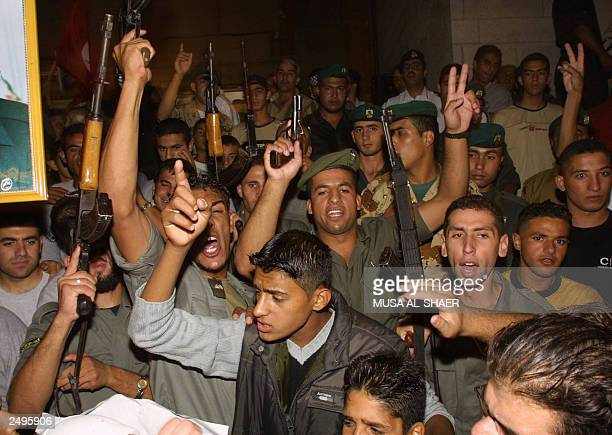 Palestinians gunmen demonstrate in support of their leader Yasser Arafat in the West Bank town of Bethlehem 12 September 2003 The Palestinian leader...