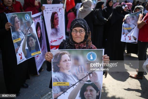 Palestinians hold a demonstration in support of Palestinian prisoners in Israeli jails outside the International Committee of the Red Cross in Gaza...