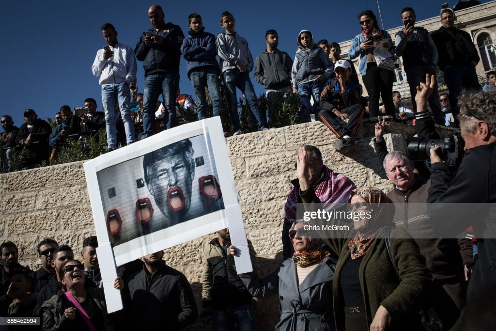 Palestinians hold a poster of President Trump as they protest outside the Damascus Gate of the Old City after Friday prayer on December 8, 2017 in Jerusalem, Israel. At least 50 Palestinians have been wounded in clashes between Palestinian protestors and Israeli security forces in the West Bank and the Gaza Strip on Friday after thousands of protestors took to the streets in a second 'Day of Rage' following U.S. President Donald Trump's decision to recognize Jerusalem as Israel's capital on Wednesday.