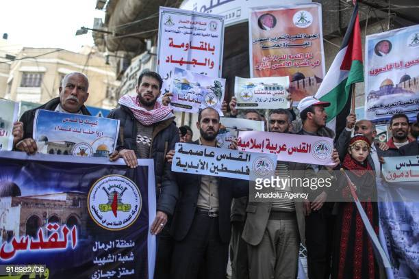 Palestinians hold banners and placards during a protest against US President Donald Trumps announcement to recognize Jerusalem as the capital of...