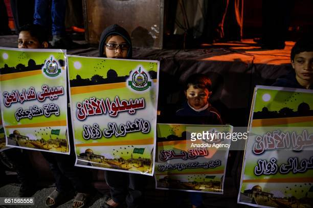 Palestinians hold banners during the protest against approval of the proposed Azan ban law by Israel in Gaza City Gaza on March 10 2017