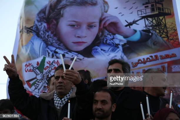 Palestinians hold candles during a support demonstration Ahed Tamimi in Gaza City on January 8 2018 Israel has charged Ahed Tamimi a Palestinian...