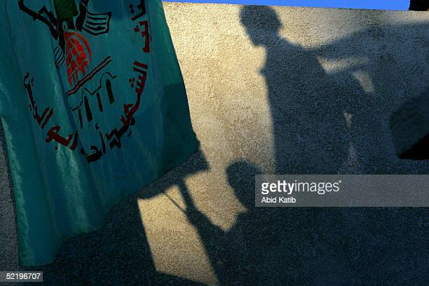 Palestinians hold national flags in celebration as 15 palestinian bodies arrive at the Palestinian parlement park after being returned by Israel on...