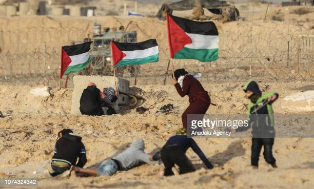 Palestinians hold Palestinian flag as they gather for maritime protest against Israels ongoing blockade of Gaza on the strips northern coast in Gaza...