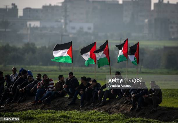 Palestinians hold Palestinian flags during a protest against US decision to recognize Jerusalem as Israel's capital in Shajaiya neighborhood of Gaza...