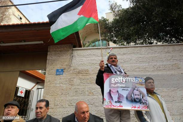 Palestinians hold poster of Ahed Tamimi during a protest to show solidarity with Palestinian prisoners held in Israeli jails in front of Red cross...