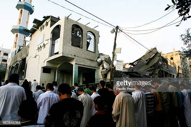 Palestinians hold their 'Eid alFitr' prayers at AlFaruq Mosque which was destroyed a week ago by the Israeli military airstrike in Rafah at the...