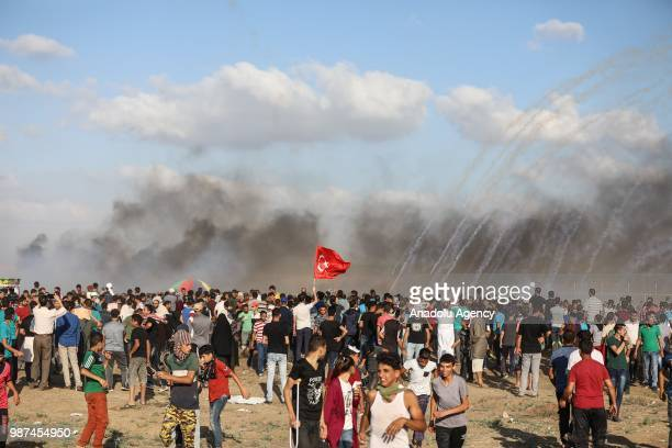 Palestinians hold Turkish flag to celebrate his presidential election success as they gather in Gaza City Gaza on June 29 2018