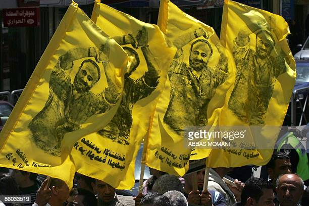 Palestinians hold up images of Marwan Barghuti a Fatah leader jailed in Israel during a rally calling for the release of Palestinian prisoners from...