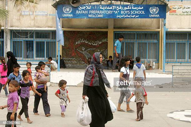 Palestinians inside the UNRWA school as they flee their houses following an Israeli ground offensive in Rafah in the southern Gaza Strip. Israel...