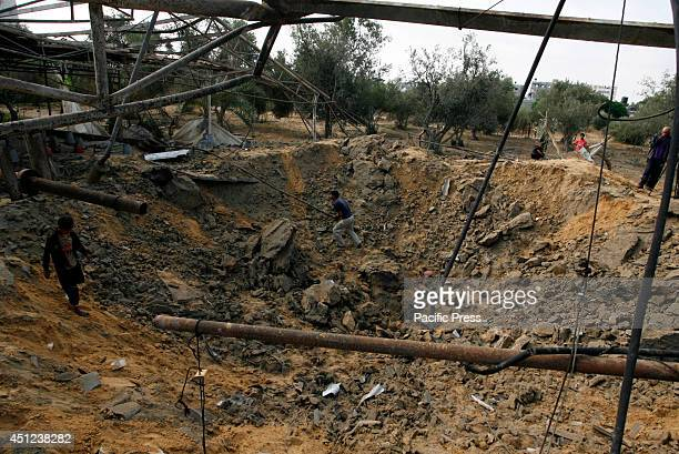 Palestinians inspect a chicken farm that was damaged by an Israeli air strike in Khan Yunis on the southern Gaza Strip The Israeli air force carried...