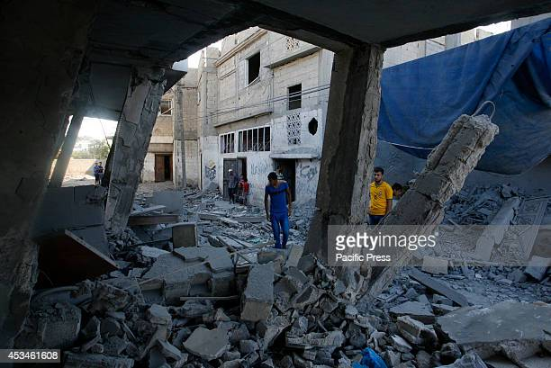 Palestinians inspect a house after it was hit by an Israeli military strike in Rafah in the southern Gaza Strip. Palestinian factions have agreed to...