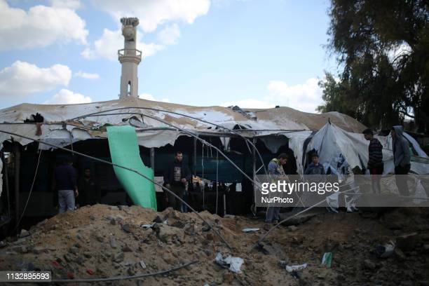 Palestinians inspect a mosque that was damaged in a nearby Israeli air strike in Gaza March 26 2019