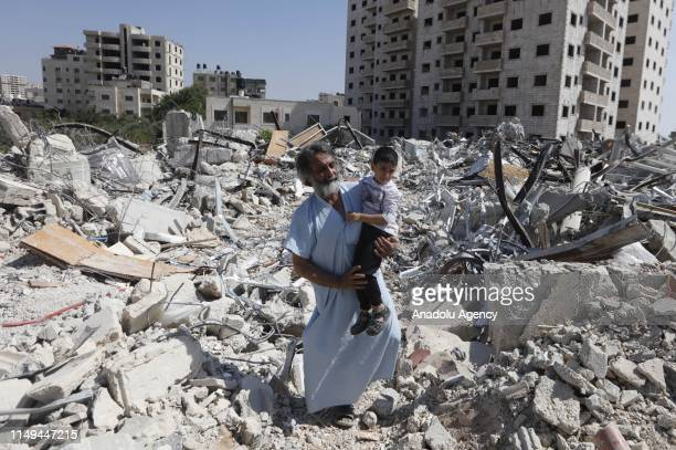 Palestinians inspect buildings demolished by Israeli authorities due to unlicensed construction license accusation at Qalandia refugee camp in...