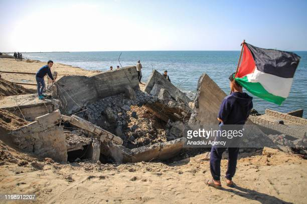 Palestinians inspect damage after Israeli airstrikes hit rainwater drainage system at Al-Shati Camp in Gaza City , Gaza on February 06, 2020.