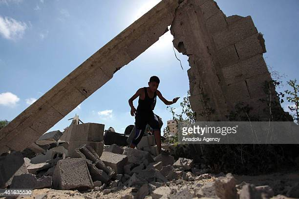 Palestinians inspect damaged areas following the Israeli air strike on July 3 2014 in Gaza City Gaza At the night of July 2 Israeli air forces...