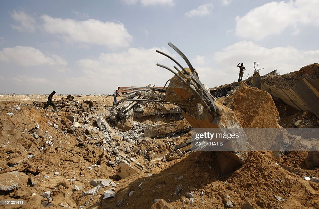 Palestinians inspect damages following overnight Israeli air strikes in the southern Gaza Strip town of Rafah on May 29, 2010. Israeli warplanes launched six overnight raids, Palestinian security officials and witnesses said, adding that nobody was wounded.