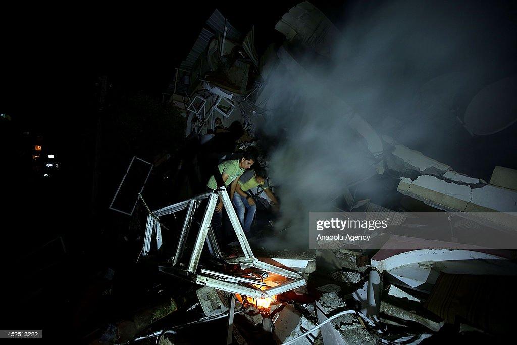 Israeli airstrike demolishes houses of Palestinians : News Photo