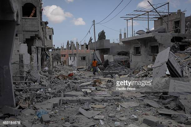 Palestinians inspect destroyed houses in Beit Hanoun in the northern Gaza Strip after Israel declared a humanitarian truce to stop the war for seven...