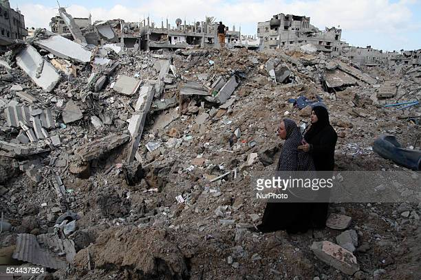 Palestinians inspect destroyed houses in the Shejaia neighbourhood which witnesses said was heavily hit by Israeli shelling and air strikes during an...