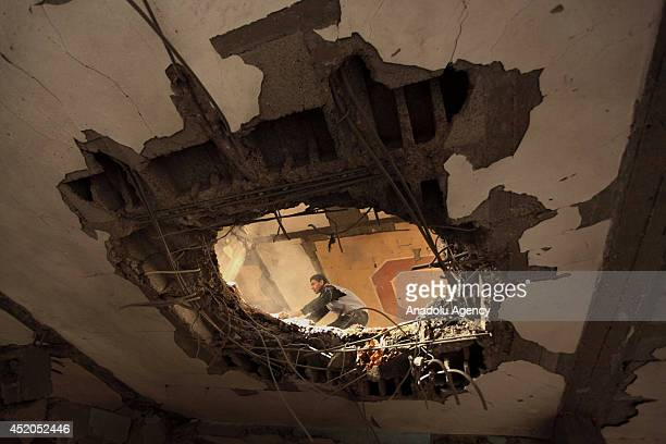 Palestinians inspect the areas, damaged within the 'Operation Protective Edge' staged by Israeli army and killed many Palestinians in Zeitoun...